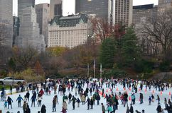 Ice-skating people with white Christmas in Central Park, New York City, USA. Stock Photos