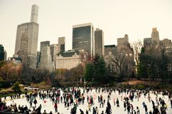 Ice-skating people with white Christmas in Central Park, New York City, USA. Royalty Free Stock Photos