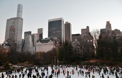 Ice-skating people with white Christmas in Central Park, New York City, USA. Royalty Free Stock Photography
