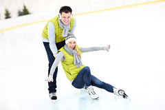 Ice skating. A picture of a young couple ice-skating on a rink Royalty Free Stock Images