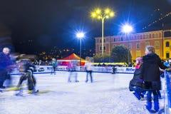 Ice skating rink at Christmas fair in Como, Italy royalty free stock photos