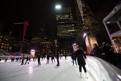 Ice Skating Rink and Skaters at Bryant Park in New York Stock Photo
