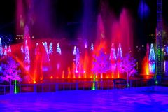 Ice skating rink, waterjet and illuminated Christmas Tree on dark night background in International Drive area 1. Orlando, Florida. December 25, 2018. Ice royalty free stock photos