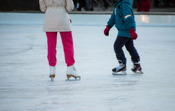 Ice skating. At the rink in winter Stock Photos