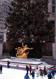 Ice Skating at the Rockefeller Plaza, New York. Ice rink and Prometheus statue in the Rockefeller Plaza at Christmas, New York, USA Royalty Free Stock Photos