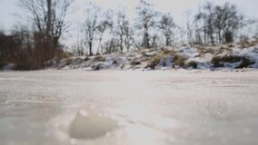 Ice skating start. Ice skater start on natural ice on a lake in the Netherlands stock footage