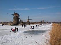 Ice skating between the windmills of Kinderdijk Stock Photography