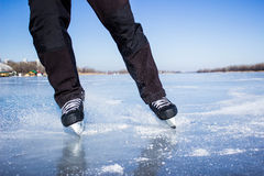 Ice skating. Winter ice skating on the open water on a sunny day Stock Photos