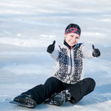 Ice skating woman sitting on ice Royalty Free Stock Photo