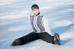 Ice skating woman sitting on ice Royalty Free Stock Photos