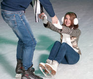 Ice Skating. Young beautiful couple smiling on the ice skating indoors ice rink royalty free stock images