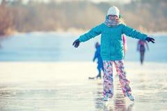 Ice skating. Young girl is skating on a natural frozen lake Royalty Free Stock Photo