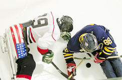 Ice sledge hockey. Two ice sledge hockey players battling for puck stock images