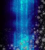 Ice and snow. Vivid icy blue glitter background with assorted size and shape of snowflakes falling gently across Stock Photos