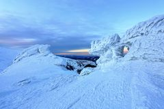 On ice and snow covered mountain top opens a beautiful view. Stock Image
