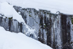 Ice and snow covered rock cliff Royalty Free Stock Photo
