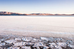 Ice and snow on the lake at sunset Royalty Free Stock Image