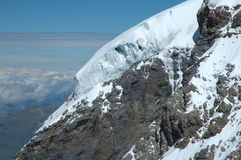 Ice and snow on rock nearby Jungfraujoch in Alps in Switzerland Stock Photo