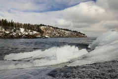 Ice and snow on the shore of Lake Superior, Shovel point in the distance. royalty free stock photography