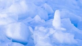 Ice and snow in the spring on the lake. Fragile ice them snow with bizarre different forms in the spring on the lake Stock Image