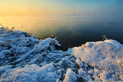 The ice and snow and water sunrise Stock Photo