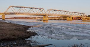 Ice and snow on the waves of the river under the bridge.  stock footage