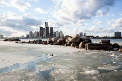 Ice and Snow on the Windsor-Detroit International Riverfront. Frozen, snow capped ice blocks floating down the river on a cold winter afternoon on the Windsor Royalty Free Stock Photo