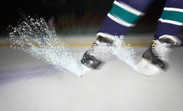 Ice sparkles from under hockey skates Royalty Free Stock Image