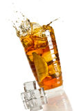 Ice splash in a glass with lemon tea Royalty Free Stock Photos