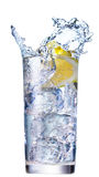Ice splashing in cup of water Royalty Free Stock Images