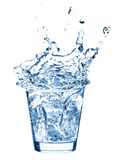 Ice splashing in cup of water Royalty Free Stock Photos