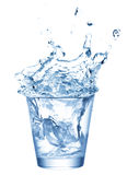 Ice splashing in cup of water Stock Photography