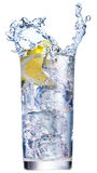 Ice splashing in cup of water Stock Photos