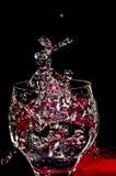 Ice splashing into a glass. With black background Stock Photo