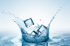 Ice splashing in water Stock Photography