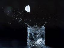 Ice splashing water stock photos