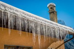 Ice stalactites on a roof Royalty Free Stock Photography