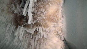 Ice stalactites and stalagmites in ice cave. stock video