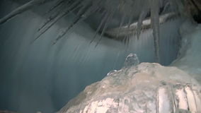 Ice stalactites and stalagmites in ice cave. Ice stalactites and stalagmites in landscape underground ice cave inside mountain in Arctic near small town stock video