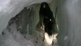 Ice stalactites and stalagmites in ice cave. LONGYEARBYEN, SPITSBERGEN, NORWAY - 03 APRIL, 2015: Ice stalactites and stalagmites in landscape underground ice stock video footage
