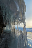 Ice stalactites and stalagmites in the rock. Stock Photo