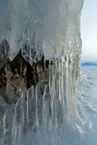 Ice stalactites and stalagmites in the rock. Stock Image