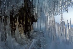 Ice stalactites and stalagmites in the rock. Royalty Free Stock Photography