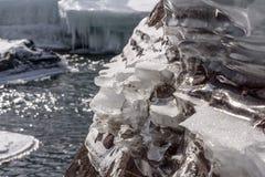 Ice stones shore pattern river Stock Photo