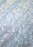 Ice surface with scratches. Surface of an outdoor ice rink replete with skate marks Royalty Free Stock Image