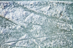 Ice surface with scratches. Surface of an outdoor ice rink replete with skate marks Stock Images