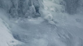 Ice surface. Water flowing under transparent ice. Winter background stock footage