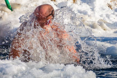 Ice swimming on Epiphany Day. UZHGOROD, UKRAINE - January 19, 2017: Ice swimming in Greek-Catholic parishioner on Epiphany Day Royalty Free Stock Image