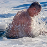 Ice swimming on Epiphany Day. UZHGOROD, UKRAINE - January 19, 2017: Ice swimming in Greek-Catholic parishioner on Epiphany Day Stock Photos