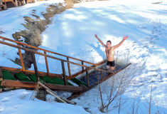 Ice swimming in the winter ice-hole after a sauna. royalty free stock photos